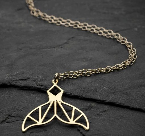 gold geometric whale tail necklace