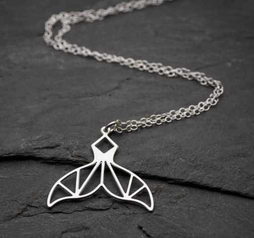 silver geometric whale tail necklace