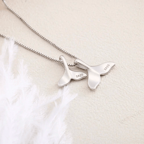 Silver whale tail necklace